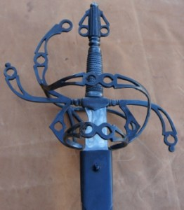 Steel sword showing pommel and intricate flowing hilt designed by David Baker