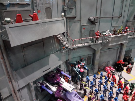Looking down on Starscream and Shockwave as a H.I.S.S. in a GI Joe diorama at Comic-Con