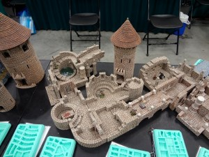 Hirst Arts tan Fieldstone Dungeon and Tower with Conical Roof for 25-28mm miniatures at Gen Con booth