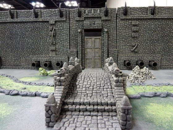 Hirst Arts plaster floor tiles and bricks arranged to create a castle or fortress at Gen Con 2012