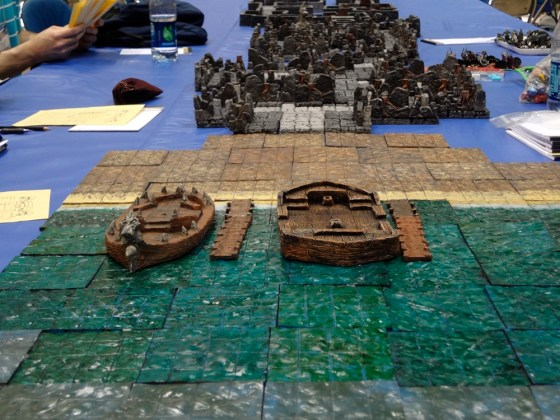 Hirst Arts dungeon for 25-28mm miniatures with miniature boats on water tiles at Gen Con