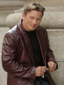 Eastern European-featured Mark Krupa posing in leather jacket for casting photo