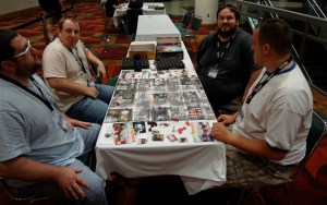 Four players at Gen Con enjoying the zombie horror board game Zombicide