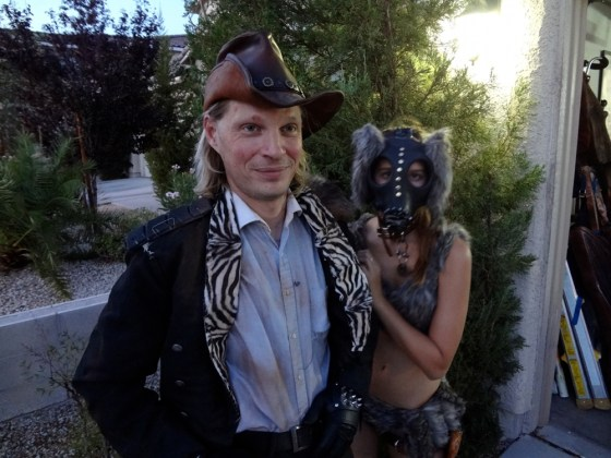 Matt Sullins in costume as Gentleman Johnny with Cowboy hat while Fur Wearing Bunny Yevette Shinn waits behind