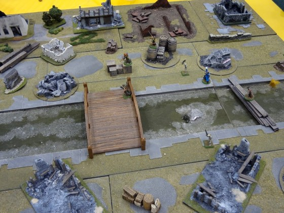 Small skirmish Mordheim warbands battle through ruined city streets in 28mm scale
