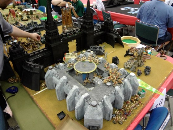 Warhammer 40k Apocalypse game unfolding with alien Tyranids versus valiant Dark Angels