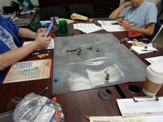 Dry erase board with miniatures for Pathfinder Society and gaming supplies at Vegas Game Day