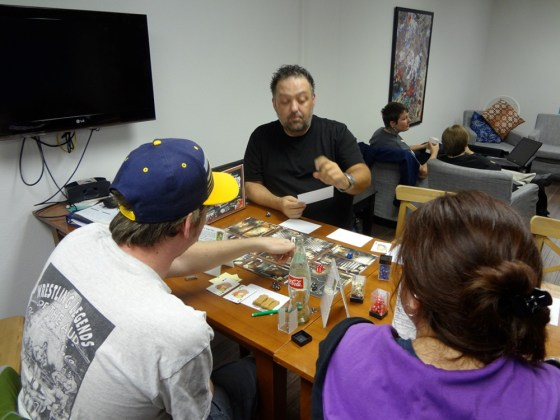 Savage Worlds GM Jerrod Gunning explains a game concept to Scooby-Doo players at Vegas Game Day.