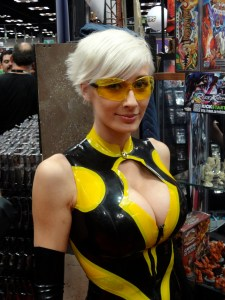 Yellow tinted glasses and yellow and black spandex on busty Hornet played by Marie-Claude Bourbonnais at Gen Con 2012