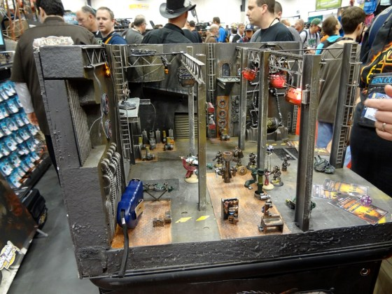 Post-Apocalyptic futuristic miniature game Dark Age industrial garage terrain at Gen Con 2012