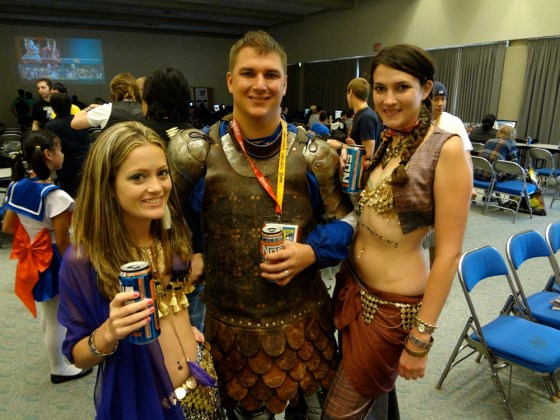 Belly dancers flank a knight in armor from the Adrian Empire at San Diego Comic-Con 2012
