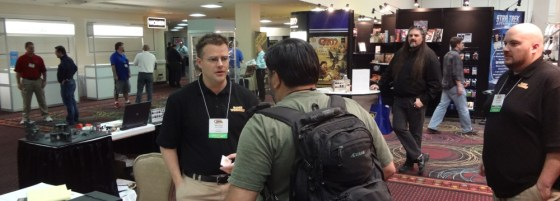 GW Employee Andre Kieren speaking with GTS Attendee at GW booth in Bally's Convention Center