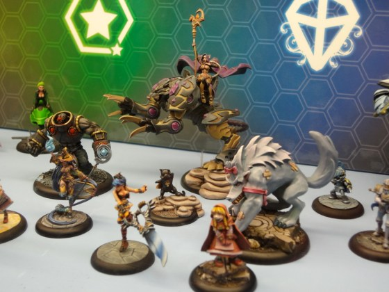 Anime-influenced miniatures for the Relic Knights game with power familiars on display at the 2012 Gen Con