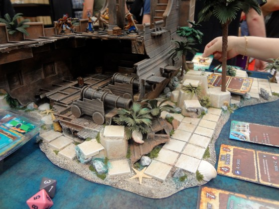 Inside a miniature pirate ship for Ron and Bones at Cool Mini or Not booth at Gen Con with cannons