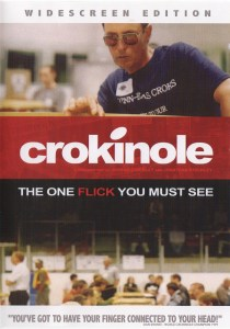 Cover of Crokinole the one flick you must see with sunglassed player in blue shirt