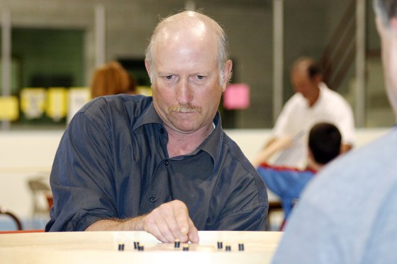 Bald-headed crokinole player Al Fuhr concentrates during World Crokinole Championships
