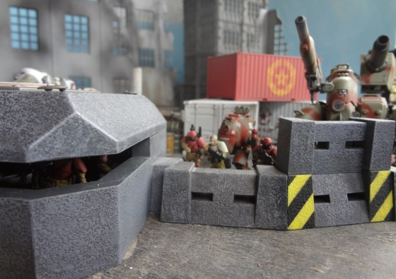 Plastic AT-43 bunker reveals figures inside while others are hidden behind tall wall sections