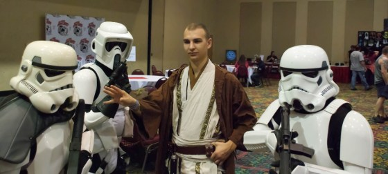 Shaved head Jedi Crow Shadowfire waves his hand to pass through Stormtroopers at Exhibition Hall at Las Vegas Comic Expo