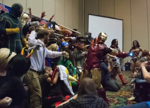 Cosplay Contest at Las Vegas Comic Expo with Iron Man standing in Front with Palms Lit up By Lights