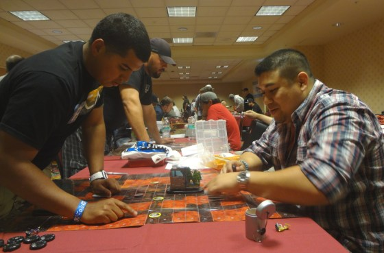 HeroClix players Justin Jimenez and Pat Yapojco face off with X-Men Team Bases in a tournament