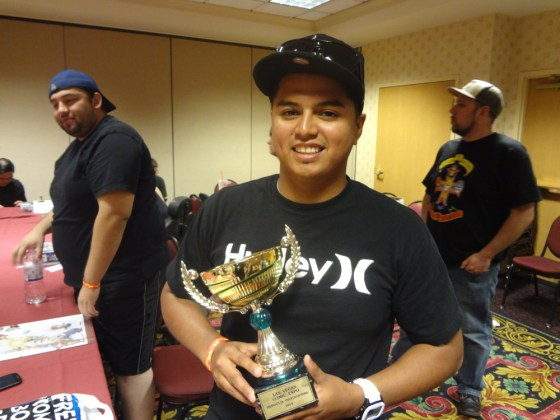Victorious Heroclix player Justin Jimenez with the 2013 Vegas ROC Trophy at the Las Vegas Comic Expo
