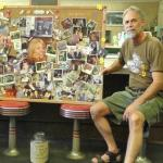 Mark Fisher, Fisher's Family Restaurant owner, is pictured with a photo collage created in memory of his late wife, Marlene. Recently, Fisher's Family Restaurant collected spare change from customers and donated the collections to the Veterans Memorial Park Relocation Fund at the Chautauqua Region Community Foundation, in memory of Marlene