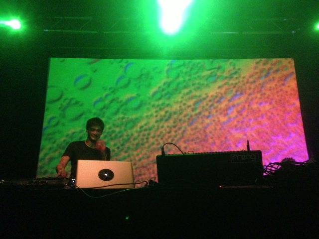Jon Hopkins, smiling as he jams to his new music in Switzerland.