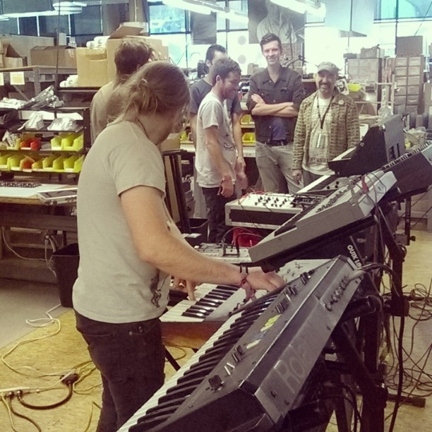 Vintage Roland, ARP, and KORG come to join the party at Moog, as the workers look on. Survive at sound check.