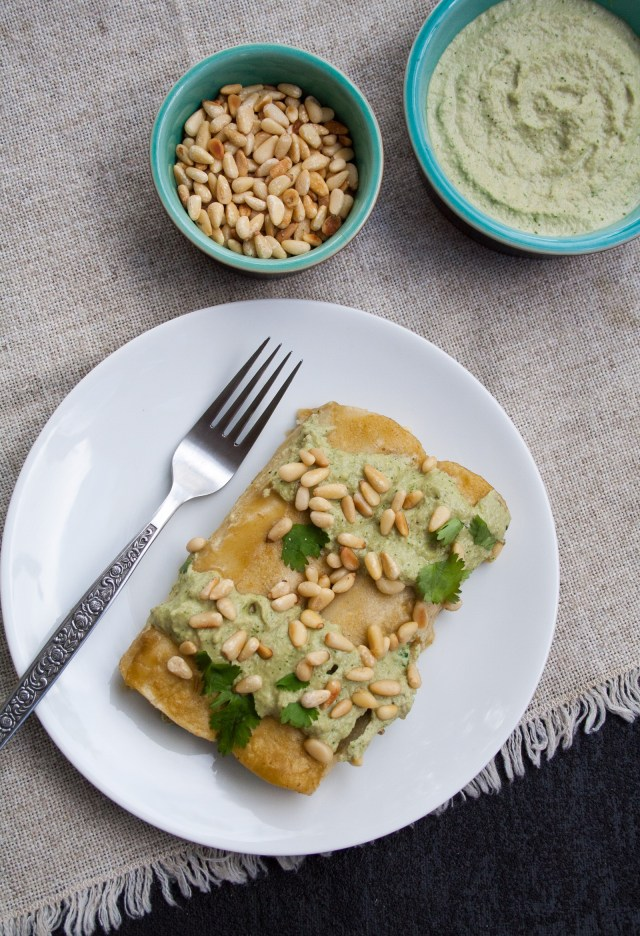 Spinach, Tofu, and Pine Nut Enchiladas - These vegan enchiladas are rich and satisfying with a creamy roasted green chile sauce. They may just become your new favorite weeknight or weekend meal!
