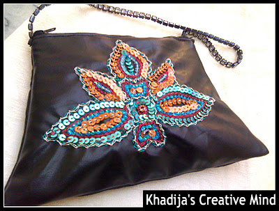hand embroidery on leather handbag