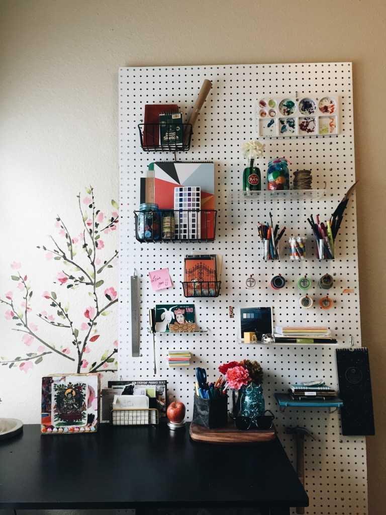 pegboard, creative workspace organized