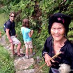 And old Yao woman hikes past us.