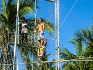 Emma, age 3, at Punta Cana swinging on the rig.