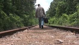 man_leaving_bag