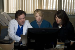 Nate, Parker, and Sophie looking at a computer monitor