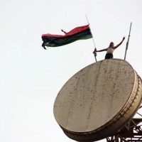Libyan flag above the communications tower in Al Bayda, Libya 2011-07-17