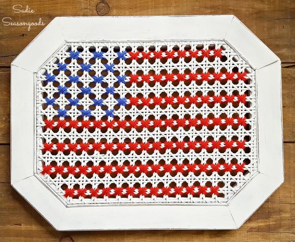Sadie_Seasongoods_broken_cane_table_repurposed_into_oversized_cross_stitch_American_flag_USA