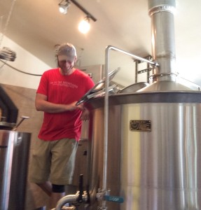 Luke stands near the brew kettle at Blowing Rock Brewing Co
