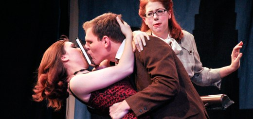 Molly, played by Sara Labor, senior of Hot Springs, S.D., holds a book between Jake, played by Michael Kruger, senior of Gordon, and the Stranger, played by Erin Neal, senior of Crawford, as they attempt to kiss. –Photo by Jennifer Parker