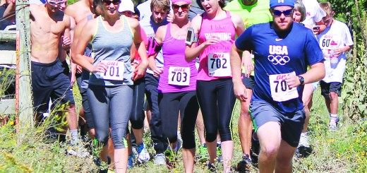 Runners for the 5k and 10k races take off Saturday during the second annual Twisted Crawdad Trail Run.  —Photo by Donna Ritzen
