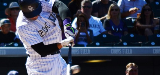 Nolan Arenado, 28, third baseman for the Colorado Rockies, makes connection with the ball Sunday during a game against the San Diego Padres at Coors Field in Denver. Arenado was 0-4 in the game.