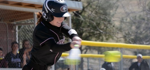 Rebekah Anthony (22), senior of Monument, Colorado, connects with a ball Sunday during a game against Fort Lewis College, at Chadron State College's Softball Field. — Photo by Jordyn Hulinsky