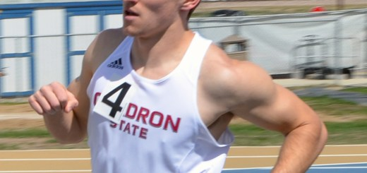 Cody Davis, sophomore of Fort Morgan, Colorado, runs around the track Saturday at the Bauer Open at South Dakota School of Mines & Technology, Rapid City.—Photo by Justine Stone