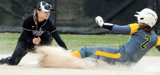 Sheyann Ludwig, freshman of Longmont, Colorado, tags Black Hills State University's Kindall Bethke (2), freshman of Belgrade, Montana, at second base Sunday in a game at the CSC Softball Field.— Photo by Jordyn Hulinsky
