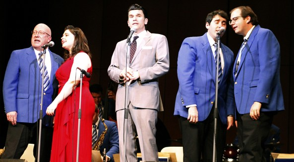 From left: Kevin Sheehan of Chicago; Maria Schafer of Long Beach, California; Nick Hilscher of Atlanta; Michael DeSousa of Milton, Georgia, and Cody Leavel of Rehoboth Beach, Delaware, perform together at the front of the stage during the Glenn Miller Orchestra concert Thursday. —photo by Brianna Wilson