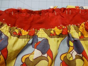 Pinned and basted gathering at top of skirt