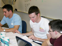 Cadets 2nd Class David Musielewicz, Robbie Winchester and Michael Nettis work a problem during Saturday's 2009 Inter-Service Programming Contest.