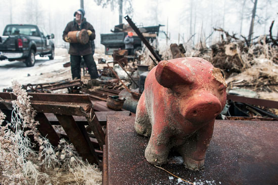 U.S. Air Force photo/Staff Sgt. Julius Delos Reyes A piggybank standing atop other debris is among the remnants of a home destroyed by the 2013 fire at Black Forest, Colo. Members of the 25th and 379th Space Range Squadrons piled scrap metal and other materials Nov. 26, 2014 as part of the squadrons' volunteer effort through the non-profit Black Forest Together.