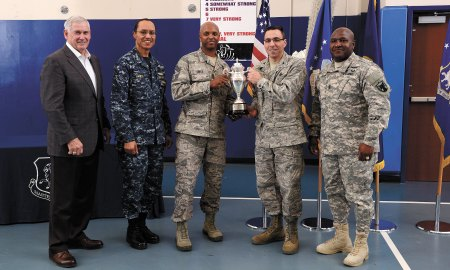 U.S. Air Force photo/Christopher DeWitt Admiral Cecil D. Haney, U.S. Strategic Command commander, presented the Omaha Trophy for Global Operations to the 50th Space Wing in a ceremony April 21, 2015, at Schriever Air Force Base, Colo. Shown are (from left to right) Lt. Gen. (retired) Bob Hinson, executive director of the National Strategic Research Institute, Haney, Chief Master Sgt. Lavon Coles, 50 SW command chief, Col. Bill Liquori, 50 SW commander, and Command Sgt. Maj. Patrick Alston, USSTRATCOM senior enlisted advisor to the commander.