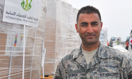 (U.S. Air Force photo by Staff Sgt. Melissa White/Released) U.S. Air Force Senior Airman Manoj Khatiwada, 21st Medical Operations Squadron aerospace medical technician, stand in front of a pallet of humanitarian assistance and disaster relief supplies, Tribhuvan International Airport in Kathmandu, Nepal, May 8, 2015. Four days after the earthquake in Nepal, Khatiwada was on a C-17 with members of the 36th Contingency Response Group on their way to Nepal. He recently finished a master's degree in Cyber Security and hopes to cross train into Cyber Defense Operations.